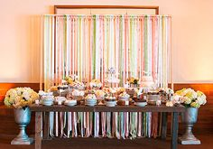 We love the idea of a dessert buffet at a casual wedding, especially because it's an easy way for guests to serve themselves. Add a personal touch with your favorite treats and a fun backdrop.  Photo by Annie McElwain Photography via 100 Layer Cake