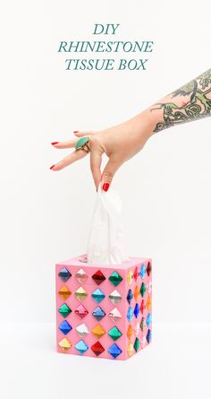 Glue rhinestones to a boring tissue box. | 25 DIY Projects That Will Fill You With Joy
