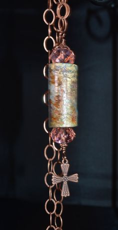 This handmade Victorian style mosaic pendant is a hand painted wine cork. Colors include coppers, golds, greens, and blue tints. The pendant is wire wrapped with 18 gauge copper wire, and champagne faceted glass crystal beads, a copper bead cap, copper spacer, and a copper cross, suspended from a copper oval links chain that is a 30 inches long. A great long length! Very unique and striking show of faith! Pictures simply do not capture the beauty of this pendant!   ** AS ALWAYS - MY JEWELRY…