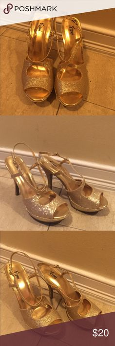 Sparkly gold heels Very fun strapped heels, the sparkly gold makes them perfect for a NYE party! Worn only once for a few hours Fioni Shoes Heels