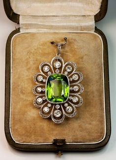 Art Deco Russian 13 Carat Peridot Diamond Platinum Pendant   From a unique collection of vintage drop necklaces at https://www.1stdibs.com/jewelry/necklaces/drop-necklaces/