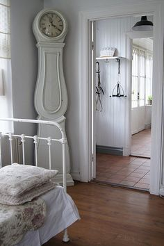 guest bedroom. clock and wall, guest bedroom