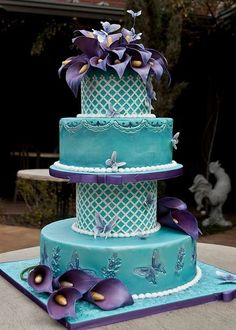 teal and purple wedding cakes | Four+tier+teal+wedding+cake+with+butterfly+imprints+and+purple+flowers ...