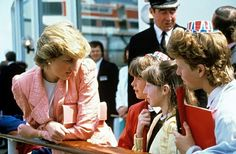 April 29, 1987: Diana, Princess of Wales comes aboard the QEII off Cowes to join 400 schoolchildren who had embarked in Southampton.