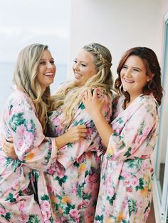Look at these lovely bridesmaids and the bride getting ready in floral robes.   Weddings   Bridesmaids   Dresses   #weddingdresses #dresses #weddings #bridesmaids   www.starlettadesigns.com
