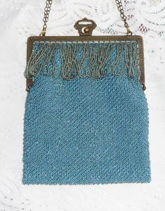 Beaded knit purse on antique frame.