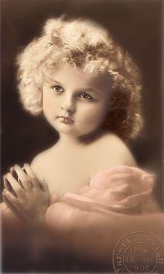 Praying    gorgeous child lighted beautifully