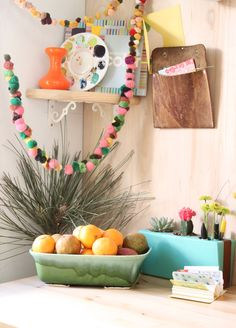 I used to make pom poms with my aunt when I was a kid, I may have to make a string of them! via Justina Blakeney