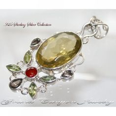 'Huge Honey Topaz Pendant w Periodot, Ruby & Topaz .925' is going up for auction at  9am Tue, Feb 5 with a starting bid of $5.