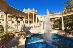 This opulent Bel-Air estate has neo-classical style with corinthian columns, free standing entablature, large geometric fountain, stone pavers around the pool, and ornate carvings on the facade of the house. Bel Air, Future House, Big Mansions, Luxury Mansions, Beverly Hills Houses, Dream Mansion, Expensive Houses, House On A Hill, Luxury Houses