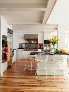New England Home: Stunning light filled open plan kitchen with golden-hued hickory floors. White Shaker ...