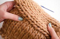Comment assembler les manches à un pull en tricot