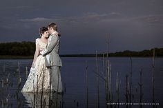 South Africa River Trash the dress photos In vintage wedding dress.