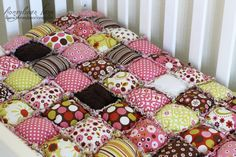 I like this version of the puff quilt, no backing, so one side has cute ruffles between the puffs.