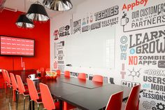 The conference room is covered in inside-jokes and brand content, helping add identity and personality to the space.
