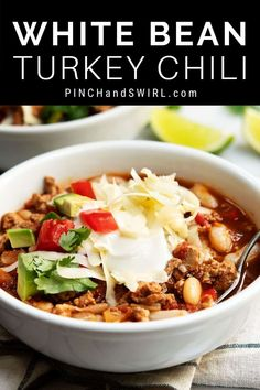 An easy, healthy recipe for White Bean Turkey Chili! So hearty and rich, you'd never guess that it's a lightened up version of your standard chili! Directions using canned beans or make them yourself in the slow cooker / Crockpot!
