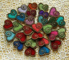 Zipper heart brooches.