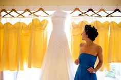 Candid shot of wedding dress and bridesmaid dresses