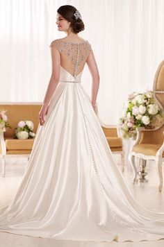 A gorgeous Diamante bateau neckline, illusion back details, Gatsby-inspired bodice pleating, and an elegantly beaded waist belt adorn this Royal Organza A-line wedding dress from the Essense of Australia bridal gown collection.