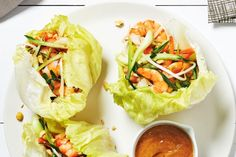 Crunchy iceberg lettuce cups are a fun (and low-calorie!) way to serve this shrimp and bok choy stir-fry. Choose the largest head of iceberg you can find and save any leftovers for sandwiches or salads. Photography by Jeff Coulson.
