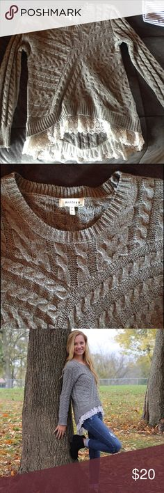 Quilted high low lace sweater This is an adorable sweater with lace peeping out the bottom. The back is a little longer than the back. Supppper warm. Size small but can fit both a s & xs. Bought at a really urban boutique in my town. Sweaters