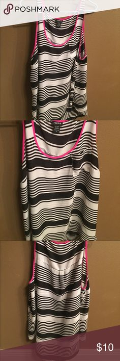 Plus Size tank from torrid. Black white hot pink Plus Size tank top from torrid. Looks nice with black pants or jeans. The hot pink gives it something extra! Size 2. Worn once. No signs of wear. torrid Tops Tank Tops