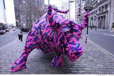 "Guerrilla crochet artist Olek's ""sweater"" for the Wall Street bull. Up for only an hour or two, but completely awesome (and harmless)."