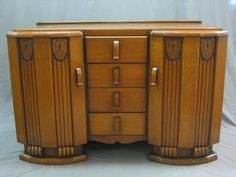1930's Art Deco honey oak sideboard, fitted 4 long drawers, flanked by a pair of cupboards