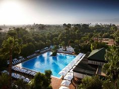 The hotel La Mamounia, in Marrakesh, is by far one of the most luxurious place to stay in Morocco. This oriental palace is the definition of a stress-free luxury holiday! You can go there for only with BnGet: Link in bio . Mamounia Marrakech, La Mamounia, Royal Palm Marrakech, Marrakech Morocco, Morocco Hotel, Visit Morocco, Hotel Swimming Pool, Hotel Pool, Pool Spa