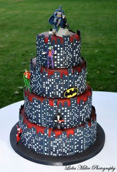 This cake has Batman, Catwoman, Joker, Poison Ivy,Penguin... its the best cake ever that I'm sure they dont want but I'm pinning it anyway just cuz!