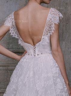 Wooooooowwwww!! https://www.etsy.com/ca/listing/213354164/vintage-wedding-gown-from-tulle-with