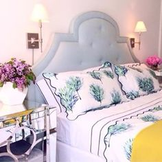 gorgeous bedroom accessories, headboard, linens, bedside table, etc.