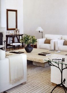 Clean lines, fresh, neutral living room. LOVE this stone table and decor!