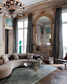 It's a modern yet antique space with incredible sofa and mirror