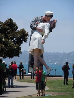 """Statue of an American sailor kissing a nurse on V-J Day from the photo taken in Times Square in New York City, on August 14, 1945. """"Unconditional Surrender,"""" Seward Johnson, USS Midway Museum, San Diego, California"""