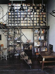 I love the metal staircase and 2 story bookshelves