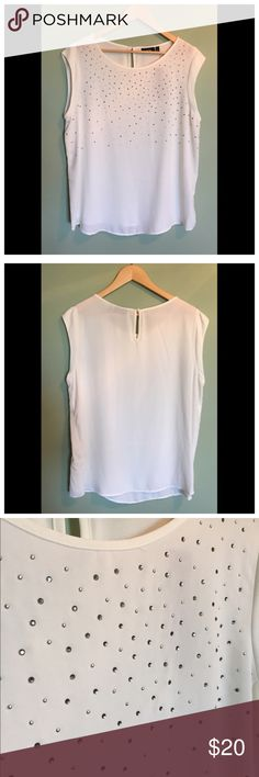 White Sparkle Top A silky fabric (100% polyester) with rhinestone appliqué. Perfect condition, never worn. With tags! Somewhat sheer. Could be great for under a blazer to make it more professional. Apt. 9 Tops Blouses