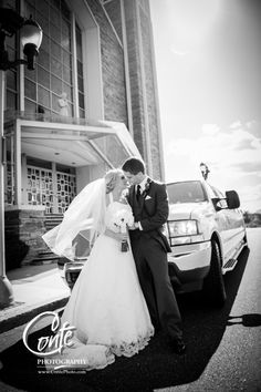 Stunning black & white photograph of the bride & groom with the Premiere 1 limo outside Saint Joan of Arc, in Hershey, PA. @premiere1limo #contephoto www.ContePhoto.com #wedding #weddingphotographer #weddingphotography #hersheypa #hersheywedding
