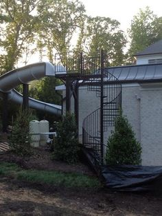 s004 Spiral Staircase and pool slide platform in McLean, Virginia by Appalachia - Spiral Staircase and pool slide platform in McLean, Virginia by Appalachian Ironworks of Va.