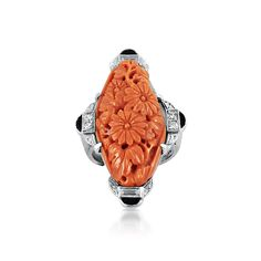 An Art Deco Coral, Diamond and Onyx Ring, circa 1925 - Sold
