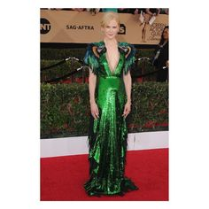 """Nominee for Female Actor in a Supporting Role for """"Lion"""" (@lionmov) at the 23rd @sagawards, #NicoleKidman wore a #Gucci emerald sequin gown featuring multicolored feather and beaded parrot embroidered sleeves and skirt with tulle ruffles by #AlessandroMichele. _____________________  o---> 💡For more outstanding outfits try: o---> 💎STATUS - The social app for Fashion Enthusiasts o---> 📥www.getstatus.co/install o---> check the link in bio  _____________________  #shopthestyle #inspiration…"""