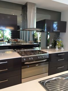 Zoom in (real dimensions: 768 x 1024)  Mirror splashback with view thru living to outside