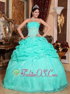 Romantic Turquoise Quinceanera Dress Strapless Organza Appliques Ball Gown  http://www.fashionos.com  http://www.youtube.com/user/fashionoscom?feature=mhee   You cannot help but be charmed by this lovely strapless ball gown!Delicate pleated bust with numerous sparkling sequins between bust and silhouette liven up the strapless bodice amazingly. The upper portion of the gown features stunning sparkling details which extend to the middle of skirt.