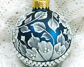Margot Clark:  Peacock MUD Ornament with Flowers and Rhinestone Band $25.00