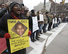 """The Smear Campaign Against 12-Year-Old Killed by Cops Has Begun   Earlier this week, authorities released video of a Cleveland police officer fatally shooting 12-year-old Tamir Rice. He was killed within two seconds of the cop's arrival at a park where he was seen holding an airsoft gun. On the same day the video was released, Northeast Ohio Media Group published a report titled """"Tamir Rice's father has history of domestic violence."""" Click to read and share full article. 11/30/14"""