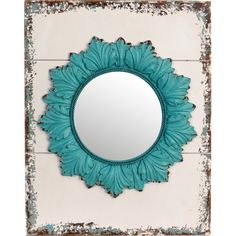 Mounted on a weathered backplate, this acanthus leaf mirror features a bold turquoise finish for a colorful touch.  Product: Wal...