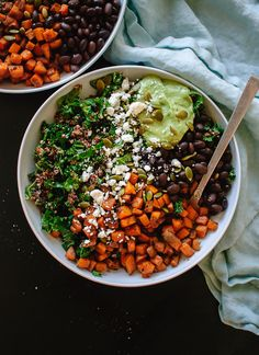Healthy kale and quinoa power salad with spicy sweet potato, black beans and creamy avocado sauce.