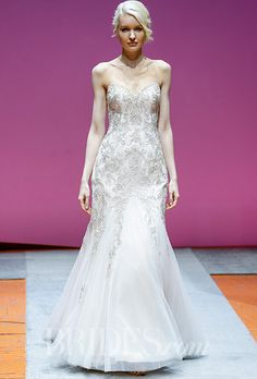 """Brides: Alfred Angelo - Fall 2016. """"Sapphire 957"""" dramatic fit and flare gown of layered soft net over satin with dramatic metallic embroidery and crystal beading encrusting the sweetheart neckline and fitted silhouette. Soft voluminous godets accent the skirt and chapel length train, Alfred Angelo"""