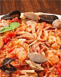 A favorite of seafood lovers, this pasta dish combines shrimp, scallops, squid, tilapia, clams and mussels with a simple marinara sauce served over linguine.