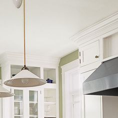 Stock Products: Handsome Cornice  Bridge the gap between cabinets and ceiling with large, one-piece polyurethane crown molding you can install yourself using construction adhesive.    Similar to shown: Charleston crown, about $51 for 6½ feet; Inviting Home.com